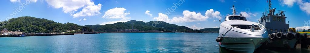 Panoramic view of seascape and moored motor boat
