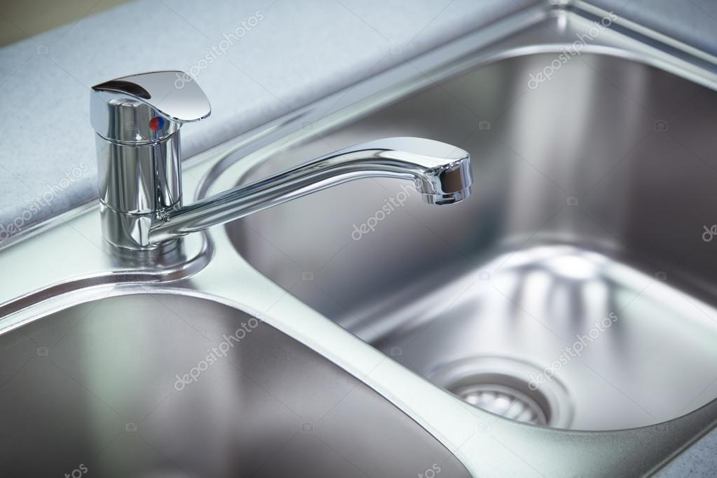 Clean chrome tap and washbasin