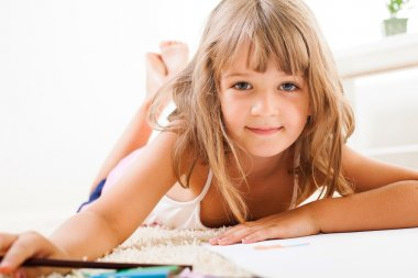 Little girl with color crayons