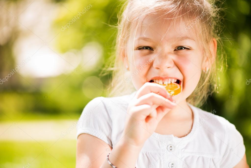 Portrait of Cute Little Girl with Lollipop