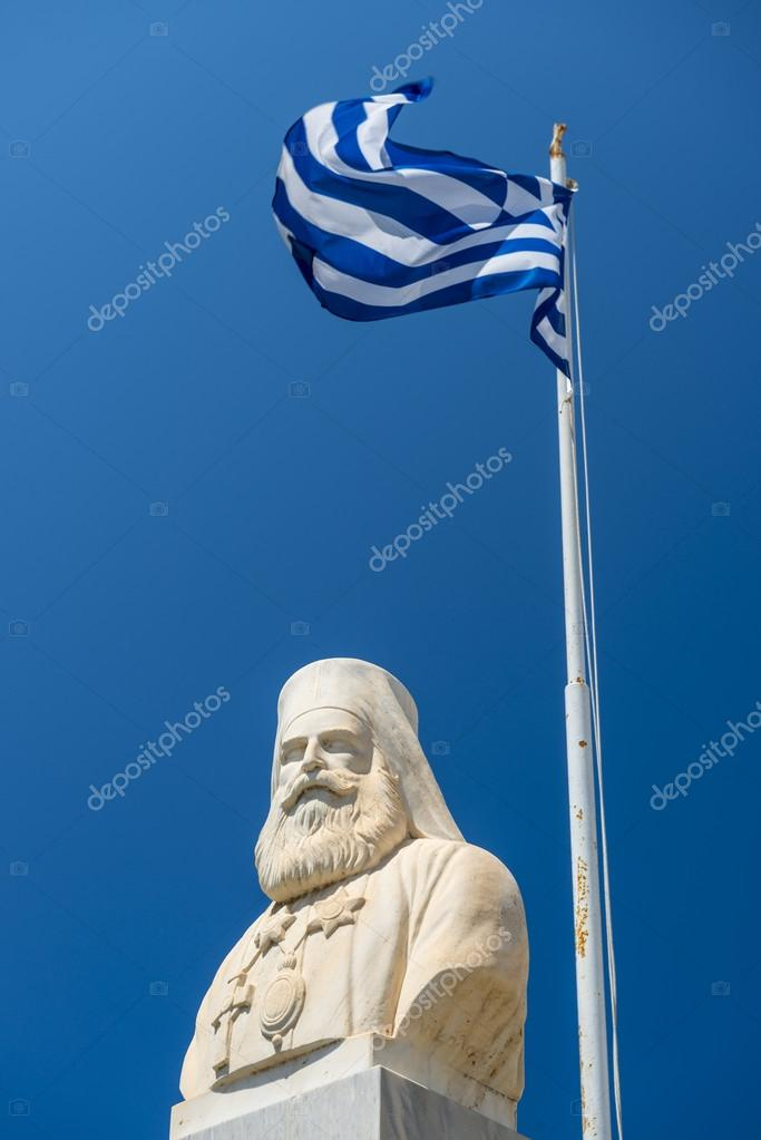 Statue Of Nikos Kazantzakis With Waving Greek Flag