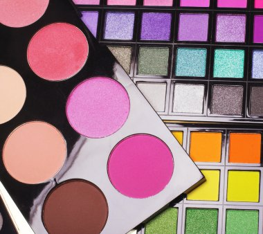 palettes with eye-shadows and powder.