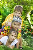 Fotografie Portrait of little kids having good time in summer environment