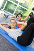 Fényképek Portré, fiatal, szép nők egyre elfoglalt edzőterem