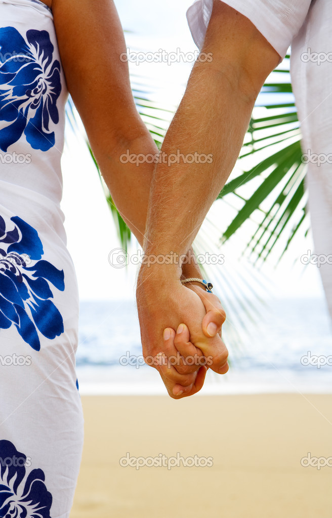 View of mans and womans hands holding together tight