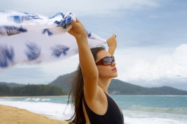 View of nice young woman with wind-blowing sarong