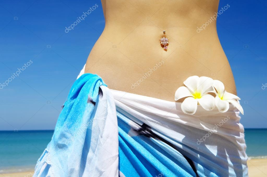 Close-up view of nice womans belly in summer environment