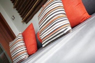 Fragment like view of nice stylish pillows upon sofa