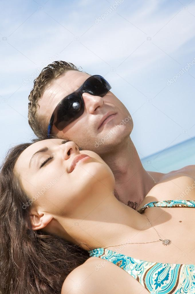 A portrait of attractive couple having fun in summer environment