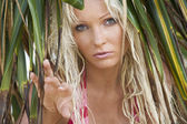 Fotografie Portrait of young pretty woman in summer environment