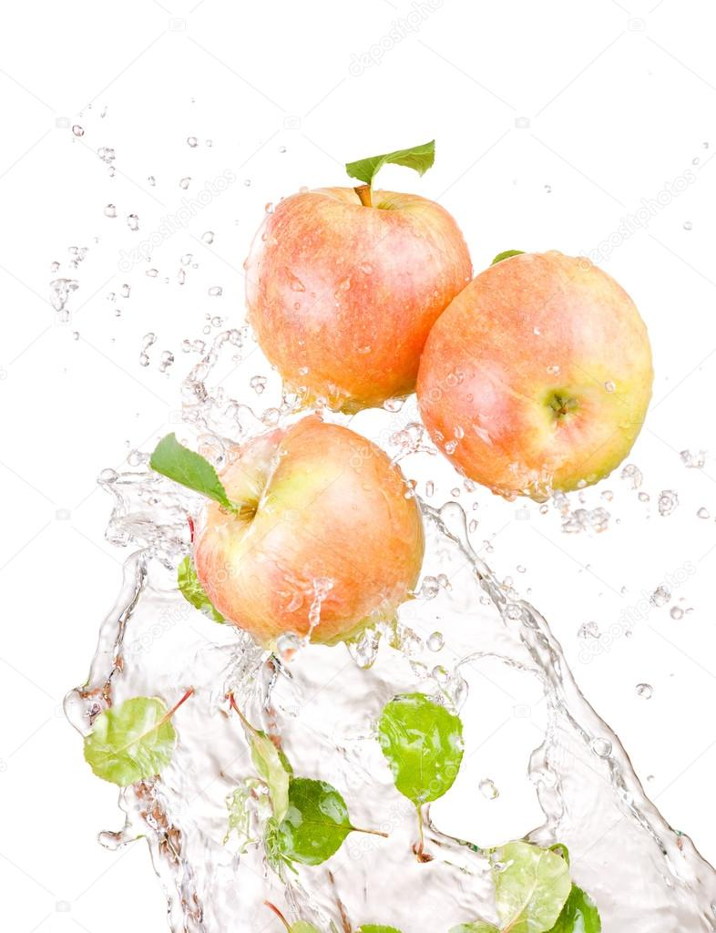 Three juicy red apple in water splash isolated on a white backgr