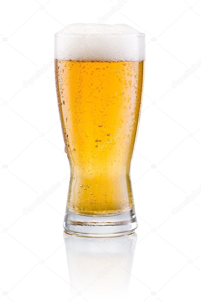 Beer glass with condensation on a white background