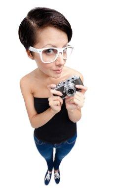 Creative woman with retro photographic camera
