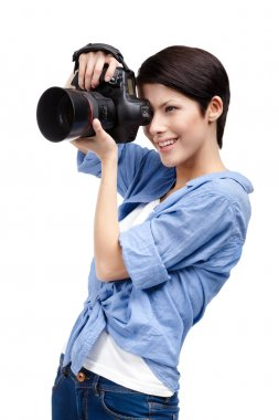Pretty woman-photographer takes snapshots