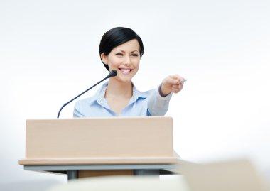 Female presenter at the board