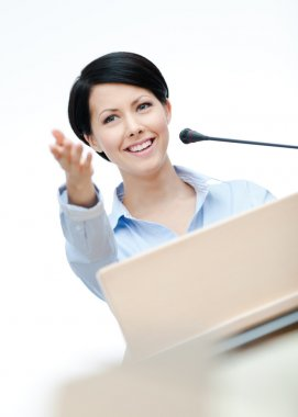 Woman speech maker at the board