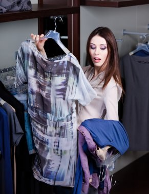 Hesitating about clothes at the store