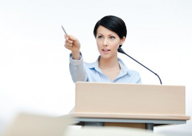 Female lecturer at the podium