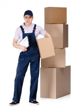 Young delivery man in overalls hands box