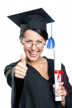 Graduating student with the certificate thumbs up