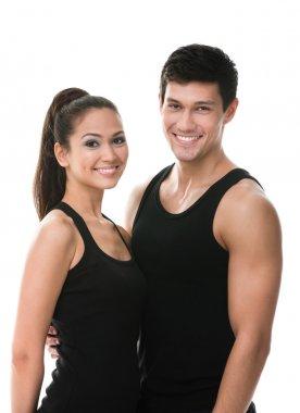Two sportive in black sportswear embrace