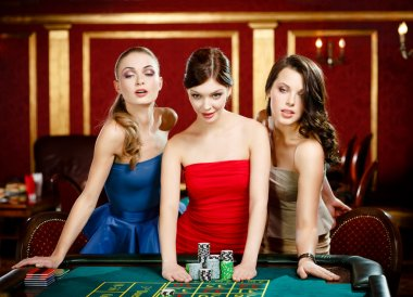 Three ladies place a bet playing roulette