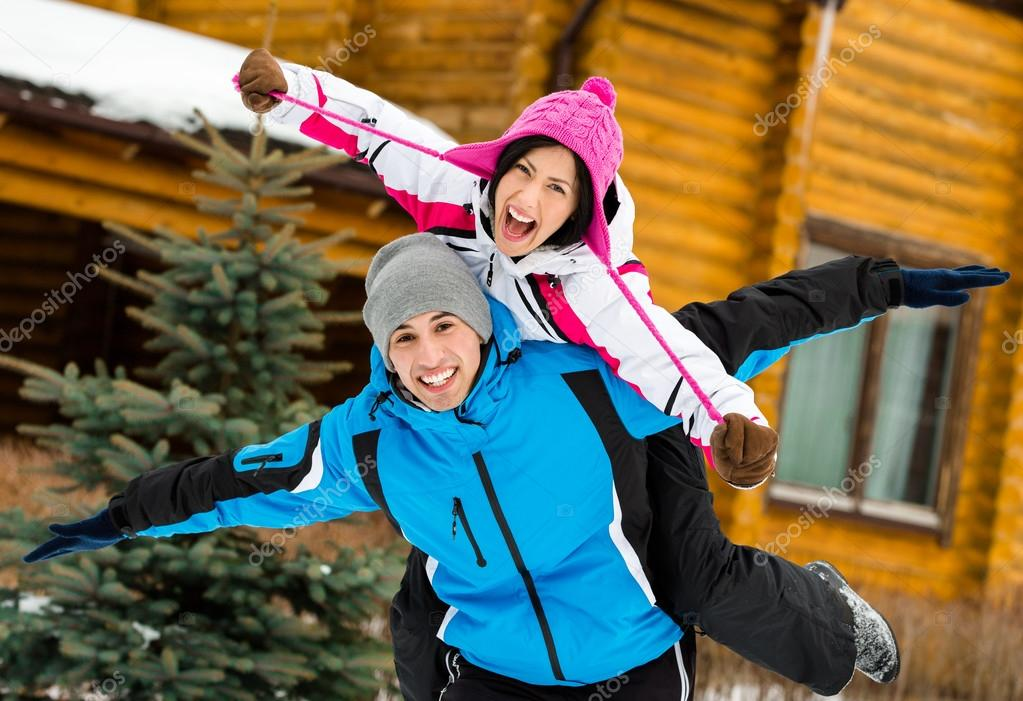 Cute couple having fun during winter holidays