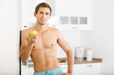 Half-naked man with apple