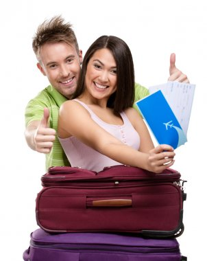 Couple with travel bags and tickets