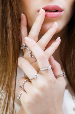 Close up shot of female hands with rings