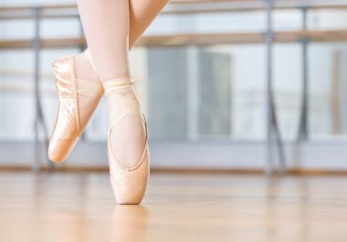 Closeup of dancing legs of ballerina in pointes