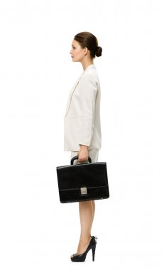Profile of businesswoman with suitcase