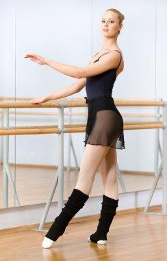 Ballet dancer dancing near barre