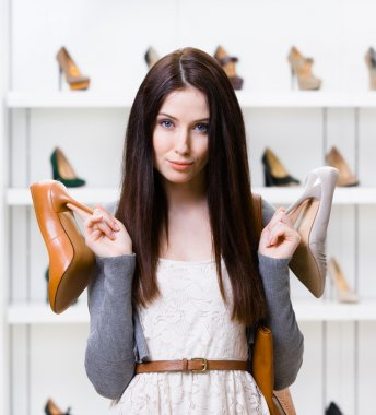 Woman can't choose heeled shoes