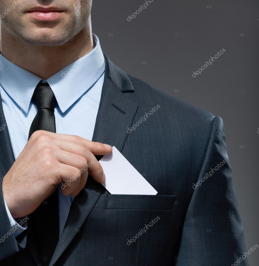 Man takes out business card from the pocket