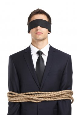 Blind-folded businessman tied with the line