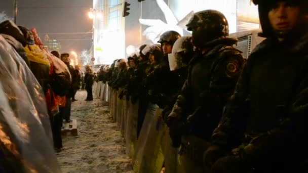 People guard during Euro maidan meeting in Kiev, Ukraine.