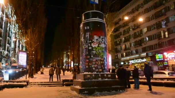 People near destroyed statue of Lenin during Euro-maidan in Kiev, Ukraine.