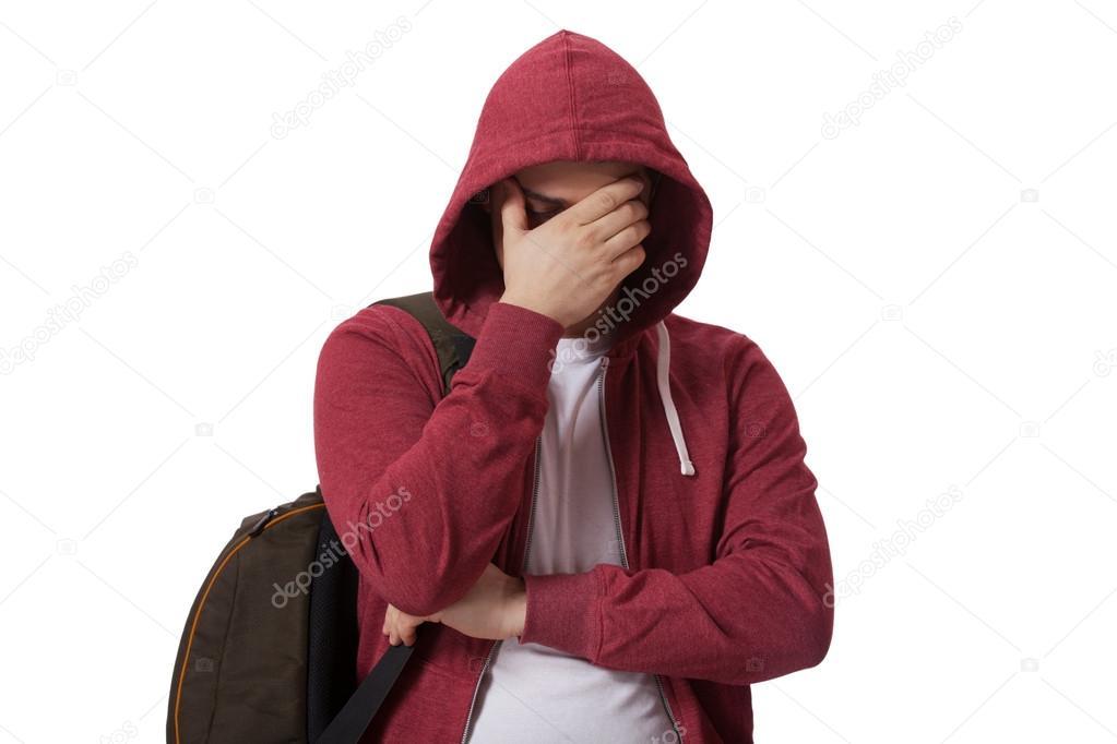 Young sad teenage boy isolated on white background