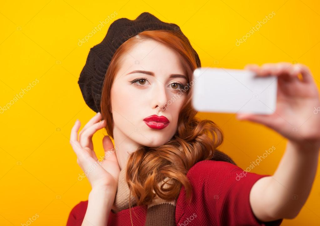 Style girl with mobile phome making self photo.