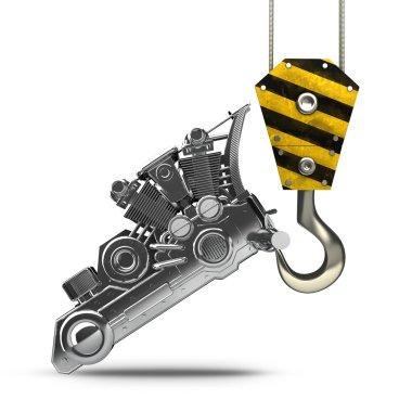 Yellow crane hook lifting chromed motorcycle engine