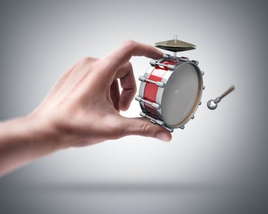 Hand holding Bass drum instrument