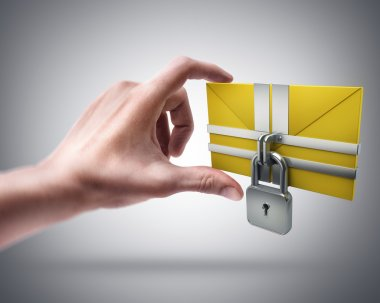 Hand holding yellow mail and lock