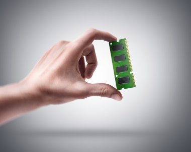Hand holding Computer Memory Card