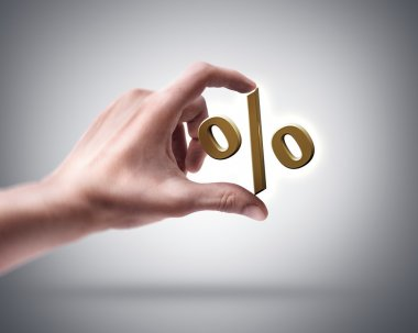 Hand holding golden percent symbol