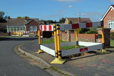 Road work warning signs and barriers