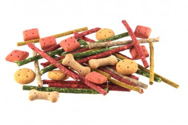Close up photo of assorted shaped dog biscuits and chews