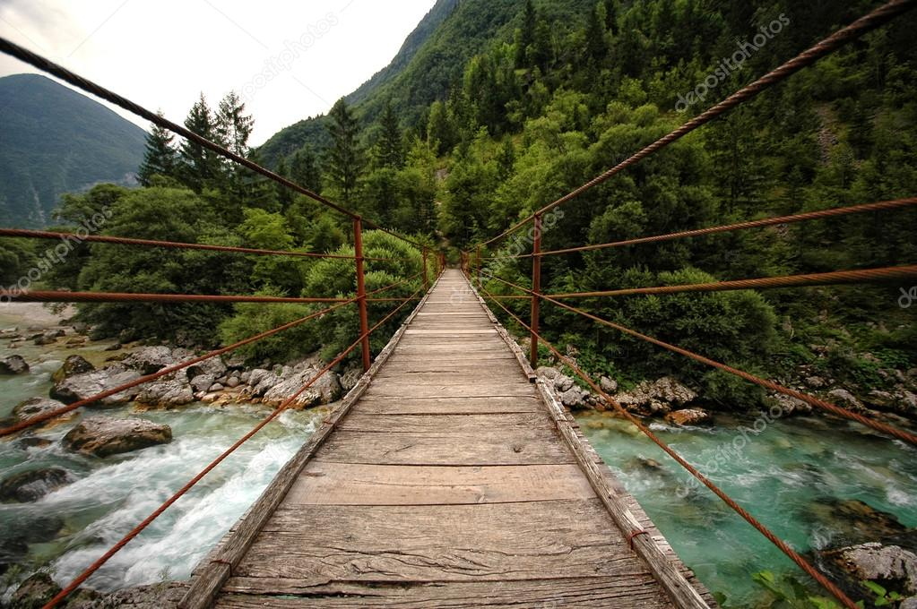 Wooden bridge over the mountain river