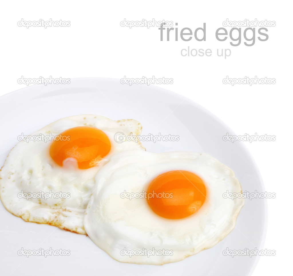 Fried Eggs On Ceramic Black Plate Royalty Free Stock ...  |Fried Eggs On A Plate
