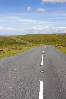 open road across dartmoor in the british countryside